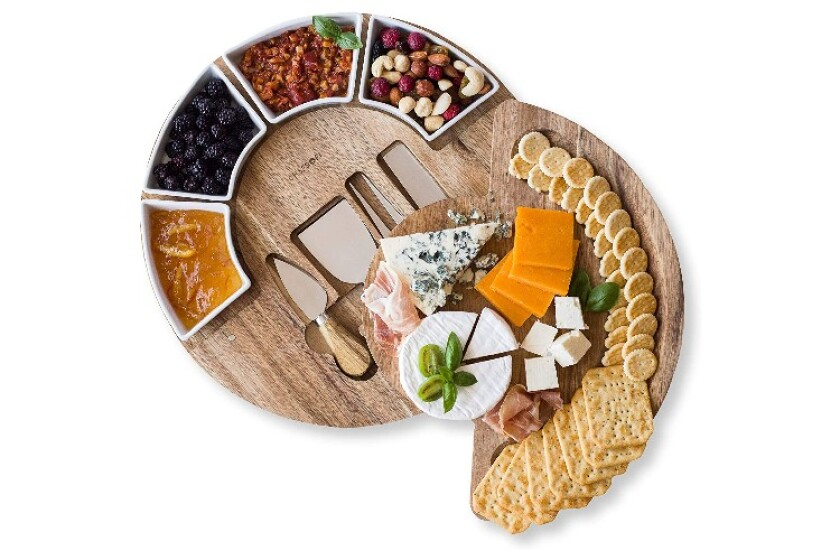 ChefSofi Cheese Board filled with berries, nuts, crackers, and cheese